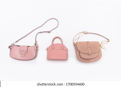 Beautiful womens three brown leather bag isolated on a white background.