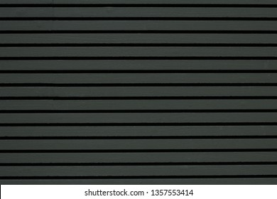 Beautiful wood plank texture and background patterns for design, cement striped wood wall, Close up dark or navy color wood substitute board and high quality fiber cement board for architecture