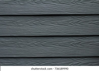 Beautiful wood plank texture and background patterns for design, cement striped wood wall, Close up dark blue or navy color wood substitute board and high quality fiber cement board for architect