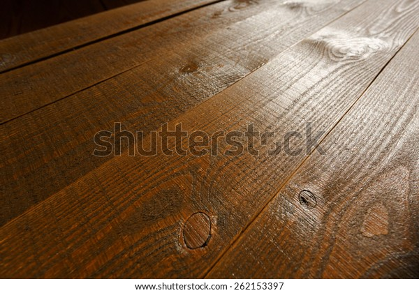 Beautiful wooden background, brown, backlit with shallow depth of field