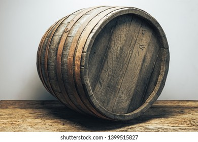 Beautiful wooden barrel on a old oak wood table  white wall background.