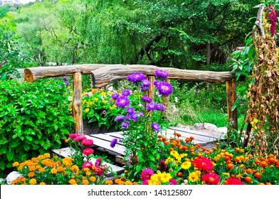 Beautiful wooden bridge and lot of greenery with flowers around