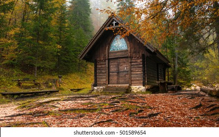 Beautiful wooden chapel in the autumn forest