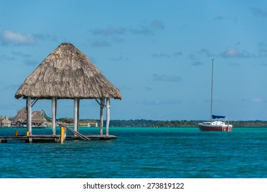 Beautiful wooden Dock at Bacalar Lake traveling riviera maya. Mexico adventure.