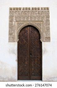 Beautiful wooden door inside the Alhambra, which is located in Granada, Spain.
