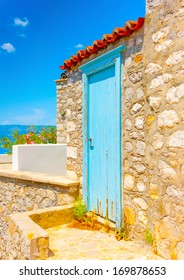 Beautiful wooden door of a traditional old house in Hydra island in Greece