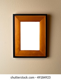 Beautiful wooden frame on wall with blank space. Empty template ready for your custom image or text.