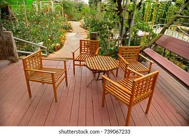Beautiful wooden garden chair in the garden Rose garden