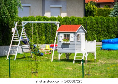 A beautiful wooden house for children and a garden playground