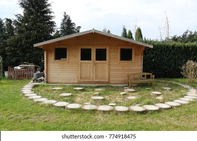 beautiful wooden house in the garden with decoration - House Garden Decoration