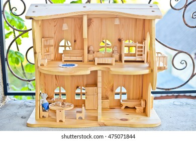 Beautiful wooden house for a knitted mouse