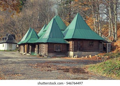 Beautiful wooden houses in autumn forest