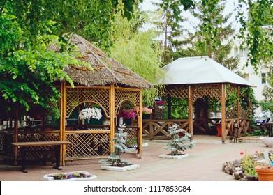 Beautiful wooden pergola in the garden. Landscape design.