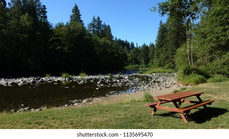 Beautiful wooden picnic table by the Lewis River in Lewisville Regional Park, Battle Ground, WA