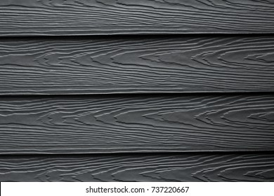 Beautiful wooden plank patterns from cement striped wood wall, Close up black wood substitute board and high quality of fiber board  texture and background for design and architect