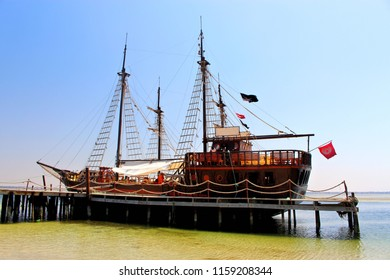beautiful wooden ship in pirate style has docked