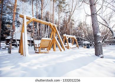 beautiful wooden swings in winter