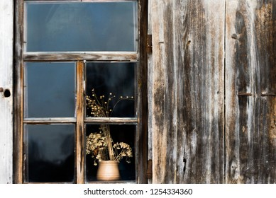 Beautiful wooden window with a flower