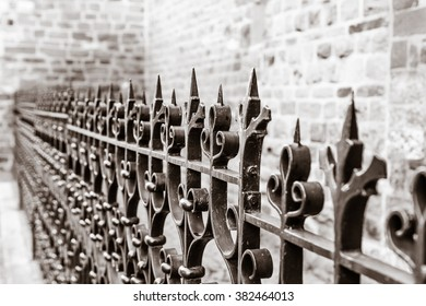 Beautiful wrought iron fence. Sepia.