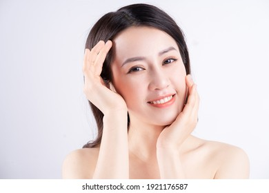 Beautiful xing woman with fresh skin smiling on background