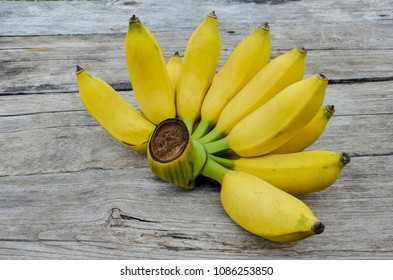 Beautiful yellow banana with delicious sweetness. On the old wooden floor.
