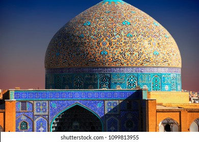 Beautiful yellow and blue cupola of Sheikh Lotfollah (Lutfallah) Mosque, with rich floral tile decoration and fragment of lancet arch, Naghsh-e Jahan Square, Isfahan, Iran (Persia), Middle East