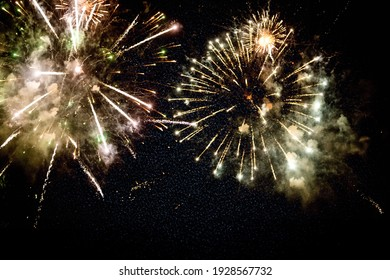 Beautiful yellow firework on black background. A firework explodes at night.