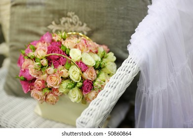 Beautiful yellow and pink roses composition with a wedding veil