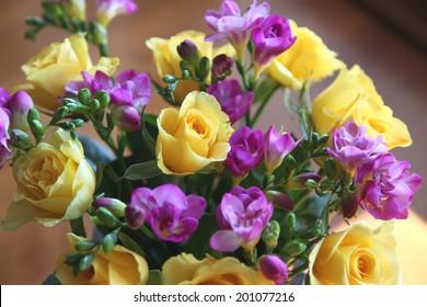 beautiful yellow rose and purple fressia flowers