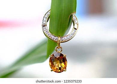 Beautiful yellow topaz earring with green leaf
