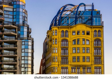 beautiful yellow vintage building with another building that has a lot of glass windows, City architecture of Blankenberge, Belgium