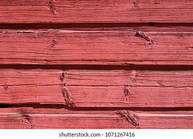 Beautiful yet rustic wooden wall photographed in old town Porvoo, Finland. Old architectural detailed photo of a red wall.