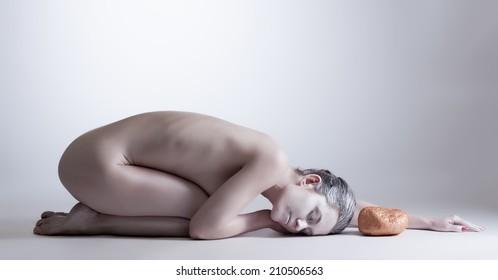 Beautiful yogi with closed eyes posing naked