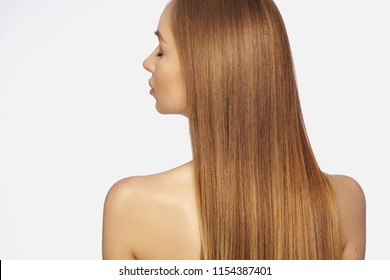 Beautiful yong Woman with Long Straight dark Blond Hair. Fashion Model with Smooth Gloss Hairstyle on White Background. Keratine Treatment