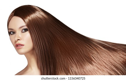 Beautiful yong Woman with Long Straight Brown Hair. Sexy Fashion Model with Smooth Gloss Hairstyle. Keratine Treatment. Horizontal studio shot