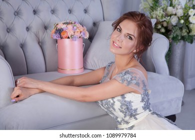 beautiful yound woman and pink flowers