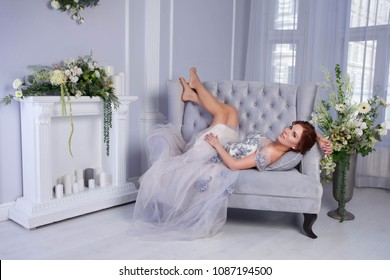 beautiful yound woman wearing blue dress