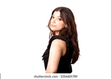 Beautiful young adult Caucasian woman in her mid 20's looking at the camera with a hint of a smile on her face. Isolated on white background.