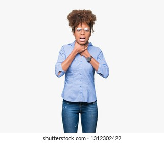 Beautiful young african american business woman over isolated background shouting and suffocate because painful strangle. Health problem. Asphyxiate and suicide concept.