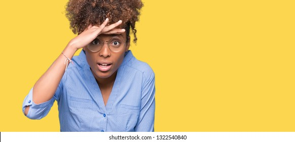 Beautiful young african american business woman over isolated background very happy and smiling looking far away with hand over head. Searching concept.