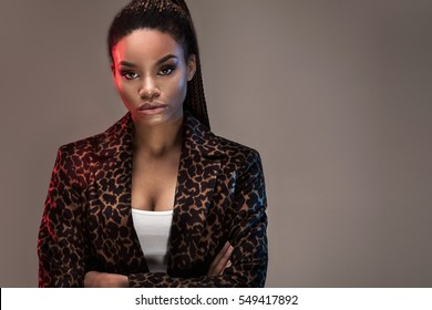 Beautiful young african american girl posing in studio, looking at camera.