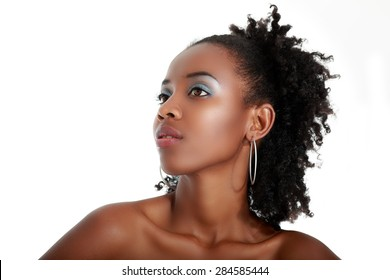 Beautiful young african american model posing against a white background
