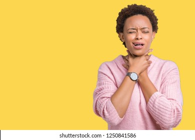 Beautiful young african american woman over isolated background shouting and suffocate because painful strangle. Health problem. Asphyxiate and suicide concept.