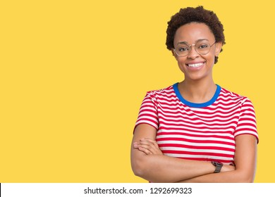 Beautiful young african american woman wearing glasses over isolated background happy face smiling with crossed arms looking at the camera. Positive person.
