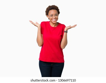 Beautiful young african american woman wearing glasses over isolated background Smiling showing both hands open palms, presenting and advertising comparison and balance