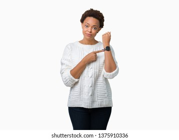 Beautiful young african american woman wearing sweater over isolated background In hurry pointing to watch time, impatience, upset and angry for deadline delay