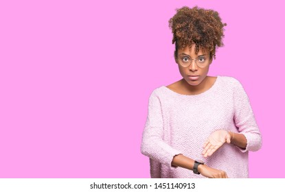 Beautiful young african american woman wearing glasses over isolated background In hurry pointing to watch time, impatience, upset and angry for deadline delay