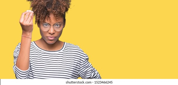 Beautiful young african american woman wearing glasses over isolated background Doing Italian gesture with hand and fingers confident expression