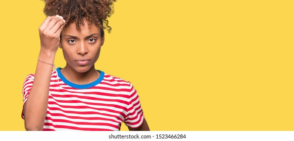 Beautiful young african american woman over isolated background Doing Italian gesture with hand and fingers confident expression