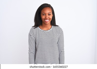 Beautiful young african american woman wearing winter sweater over isolated background with a happy and cool smile on face. Lucky person.